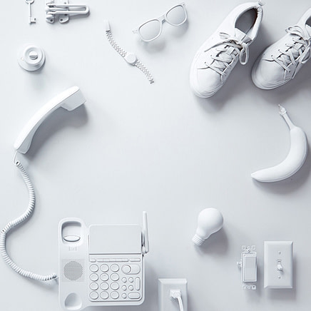 White telephone, shoes, banana, sunglasses, lightbulb and other IoT devices