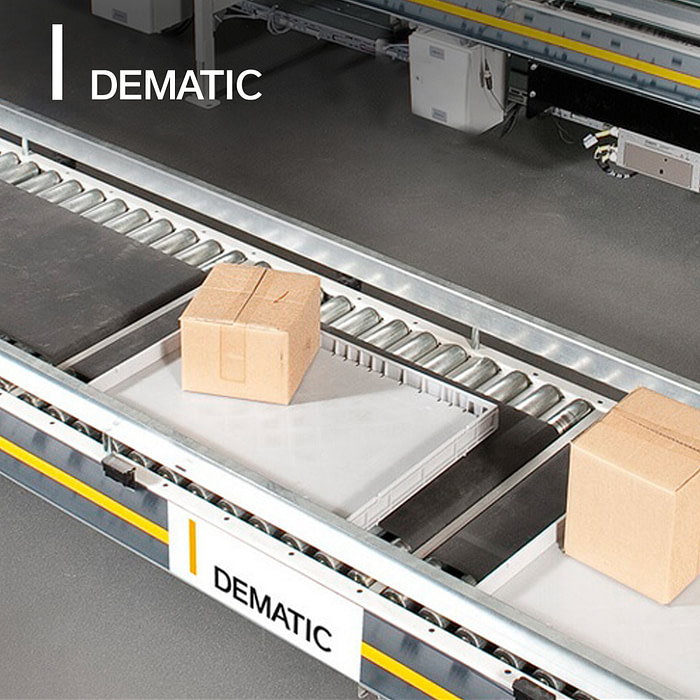 Box on conveyor belt in a large warehouse