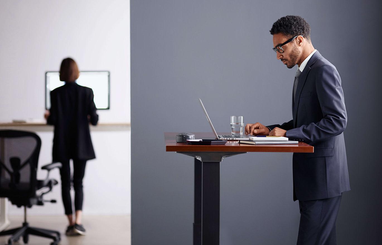 Man Standing at Herman Miller Live OS Desk