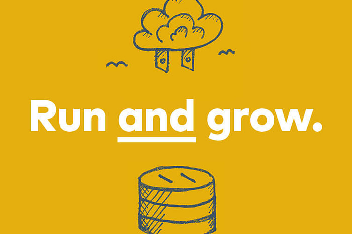 """""""Run AND grow."""" 2-pronged plug-like cloud hovering above an outlet-like silos."""