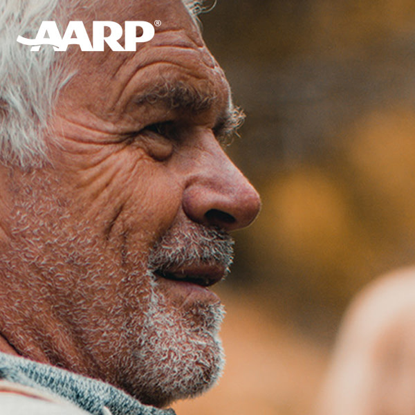 "Side profile of a white, middle-aged man's face. He has gray hair and beard and the ""AARP"" logo is in the photo."