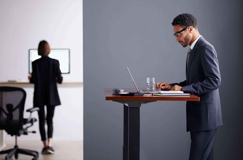 Man working at Herman Miller Live OS Desk